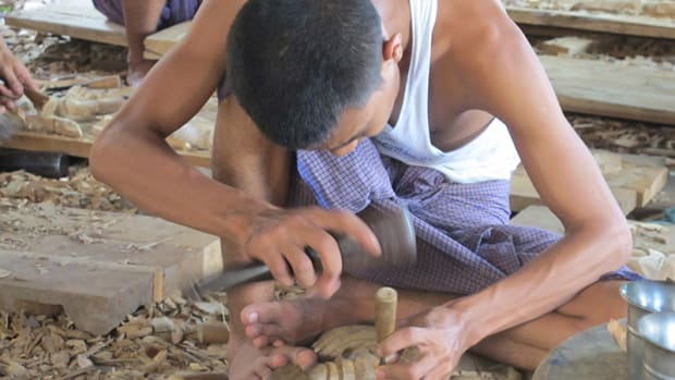 A traditional tradesperson in Mandalay refining his skills in the ancient craft of woodcarving. Unfortunately most of his work is headed for the Chinese hotel chain market. Photo by Laura Saeger
