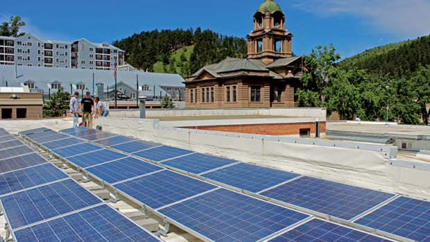 GenPro technicians Joey Davis, Bob Lavoie and Nick Licht take one last look at the recently completed solar panel installation at TDG Communications in Deadwood. The historic Lawrence County Courthouse is across the street.