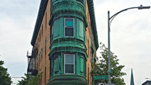 The 1899 historic flat iron building near Central Square in Cambridge, MA, now houses Charlie Allen Renovations. Allen restored the first floor and built out the basement, following historic clues in the other floors of the building and an 1899 newspaper article.