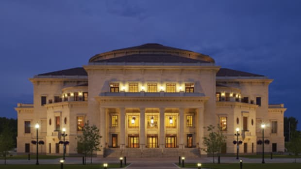 The Palladium at the Center for the Performing Arts, designed by Washington, D.C.-based David M. Schwarz Architects, defines the mixed-use City Center development of Carmel, IN. The south façade, the main entrance, faces the village green.