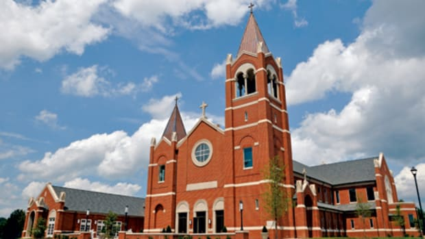 St. John the Apostle Church makes use of the red brick construction characteristic of Leesburg, VA, but departs from the typical compass orientation for such houses of worship to have the entrance better positioned in relation to the town.