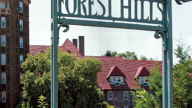 Forest Hills Gardens in New York City's borough of Queens is one of America's most successful urban garden villages. Begun in 1907 to a plan by Frederick Law Olmsted, Jr., with architecture by Grosvenor Atterbury, the center of the community is built around its Station Square connection to the Long Island Railroad – shown here with the tower of the Forest Hills Inn in the background.