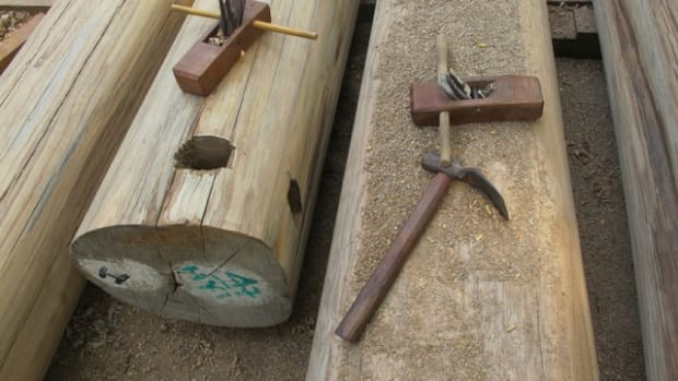 Traditional carpenters tools in Myanmar. The holes in the log are for chains that the elephants use to skid the logs out of the forest.