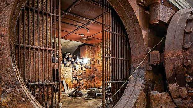 By design, the basement bank vault, in all its rusted glory, has essentially been left as found.