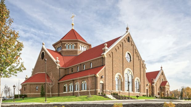 Romanesque façade details at Saint Paul Apostle Catholic Church were derived from the historic commercial Uptown architecture of Westerville, OH.
