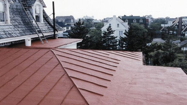 This metal roof has been treated with a waterproofing, elastomeric Acrymax coating from Preservation Products.