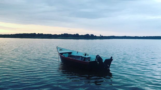 wood boat on the water