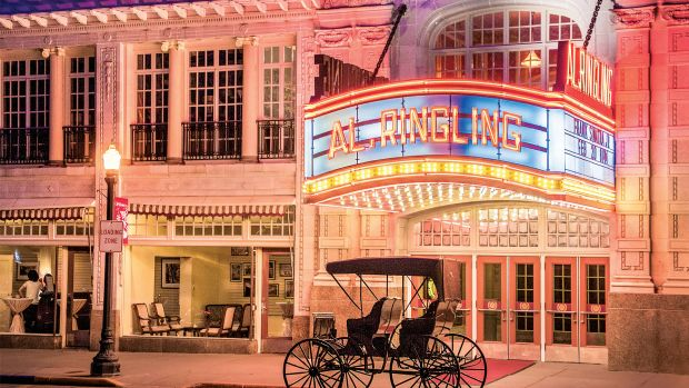 The restored marquee welcomes visitors to the Al. Ringling Theatre. Al. Ringling's restored private carriage waits out front.