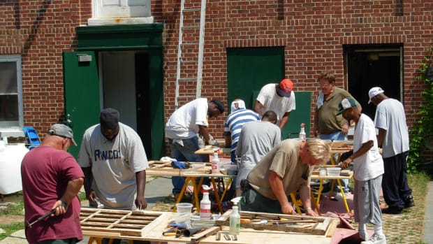 """Highly skilled and respected tradesperson Robert Yapp Jr. (top right with glasses) teaching a class at his grass roots """"Window Restoration College"""""""