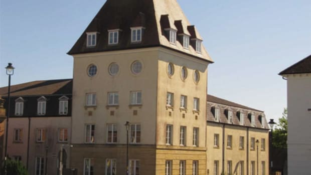 LOCALIZATION: Homogenization of global architecture dismays those who value unique local character. Shown here is the new planned community of Poundbury in England, which uses local vernacular architecture to maintain visual continuity with the connecting town of Dorchester.