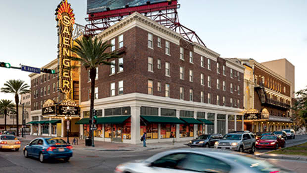 The Saenger Theatre, a historic landmark in one of New Orleans' nine historic districts, has a prominent place on Canal Street. It was enlarged with the addition of the neighboring building at right, which used to be a Popeye's fast-food restaurant. All photos: Will Crocker
