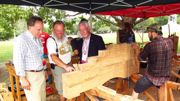 Ron Staley (left), of The Christman Company, a sponsor of the cannon carriage workshop, and David Woodcock (right), former president of APT, join me in appreciating the workmanship of the students.