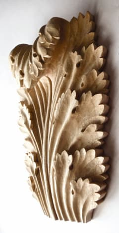 This traditionally styled acanthus leaf applique was hand carved by Agrell Architectural Carving.