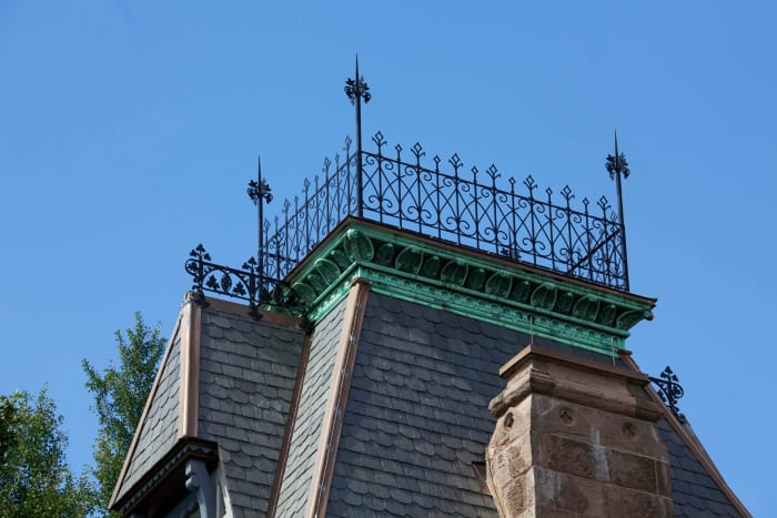Allen Architectural Metals, Inc. reproduced the cast iron cresting that decorates each pitched roof ridge of the Residence and Visitor's Cottage in Greenwood Cemetary, New York. The elements were created based on the remaining original elements.