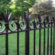 This custom fence was designed and fabricated by Wiemann Metalcraft using solid-bar steel; to ensure longevity, it was galvanized before urethane coating was applied.