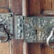 This decorative floral-patterned door hardware system was restored by Ball & Ball Hardware.