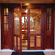 This historically styled wood door with sidelites was fabricated by Vintage Doors.
