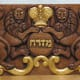 This Mizrah wall plaque was hand-carved by Deborah Mills in mahogany.