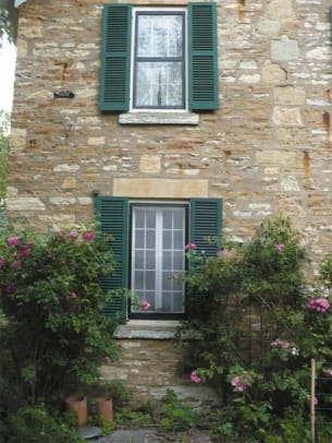 shuttercraft-stone-house-green-shutters