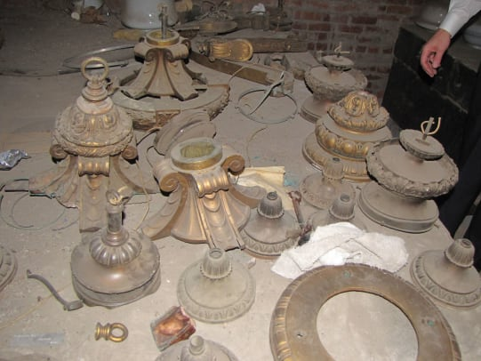 K. Attic storage of unusable Guth plated plaster fixtures at the Oklahoma State Capitol