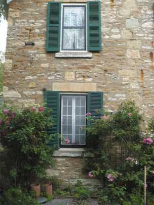 shuttercraft-stone-house-green-shutters