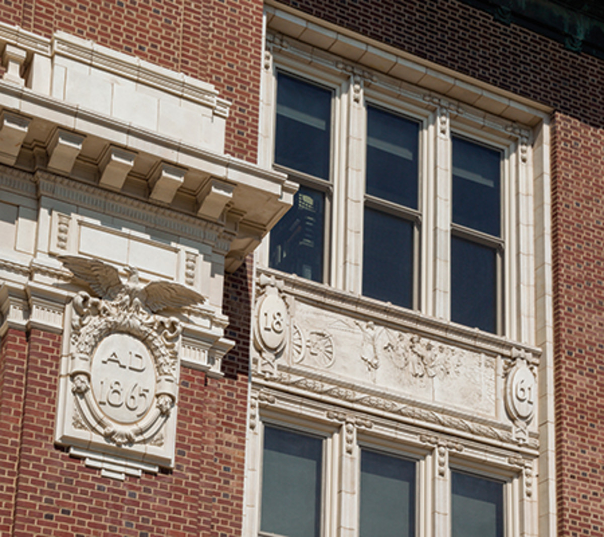 Rather than replace missing portions of the terra-cotta elements and plaques on the exterior, an art conservation approach was used to preserve them. Photo: Photography by © WayneCable.com