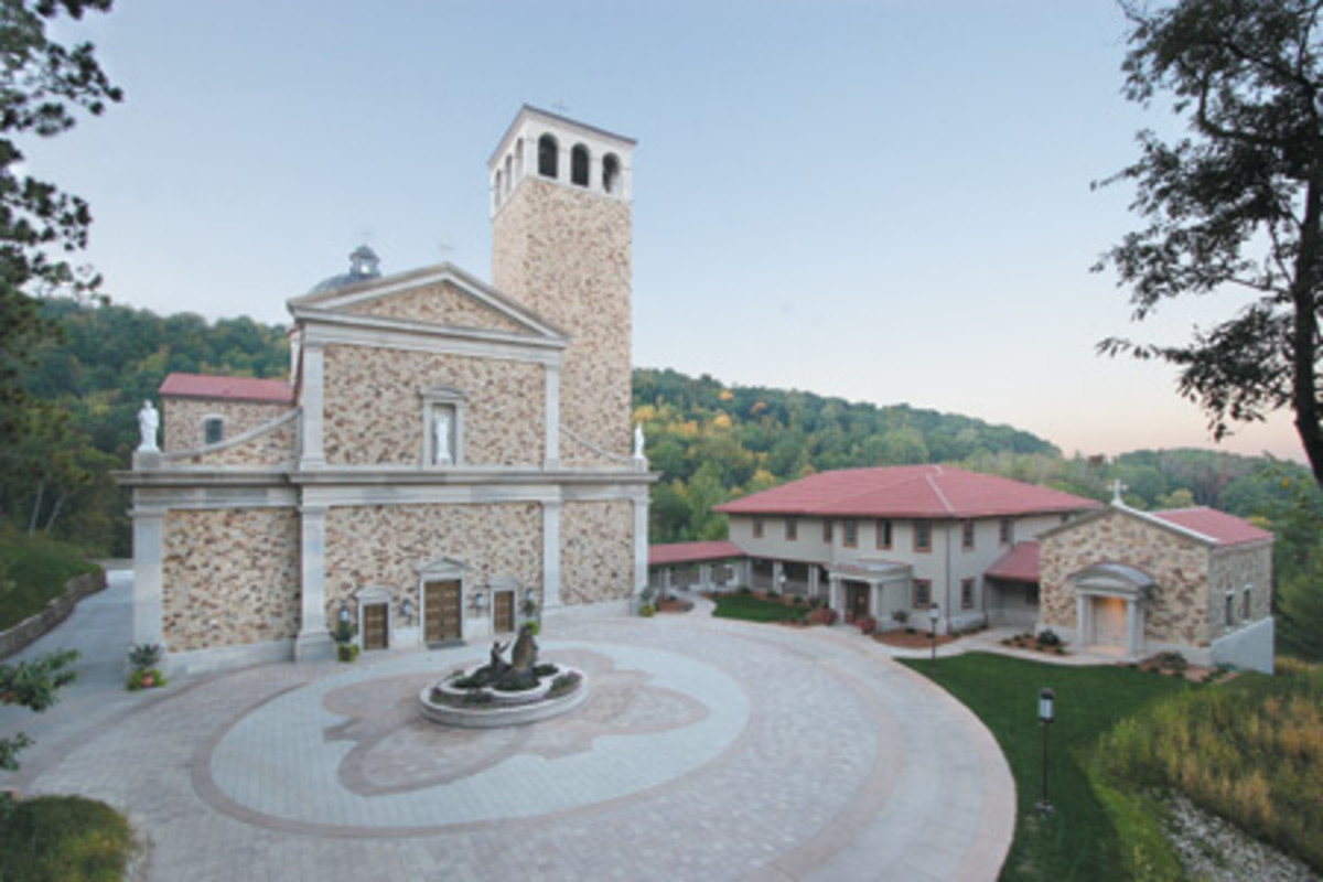 The church building is part of a complex of buildings in the hills outside of La Crosse, WI. The exterior was designed to look like a simple Tuscan building. Stone from Minnesota and Wisconsin was blended to create the colorful appearance, while gray limestone was used for the cut details.