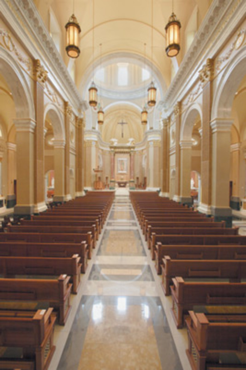 The dramatic interior of the sanctuary of Our Lady of Guadalupe was designed to look like a high renaissance or baroque church. John Canning Studios was responsible for the decorative work, including the cast plaster ornament and painting. Lighting fixtures were supplied by Winona Lighting, Winona, MN.