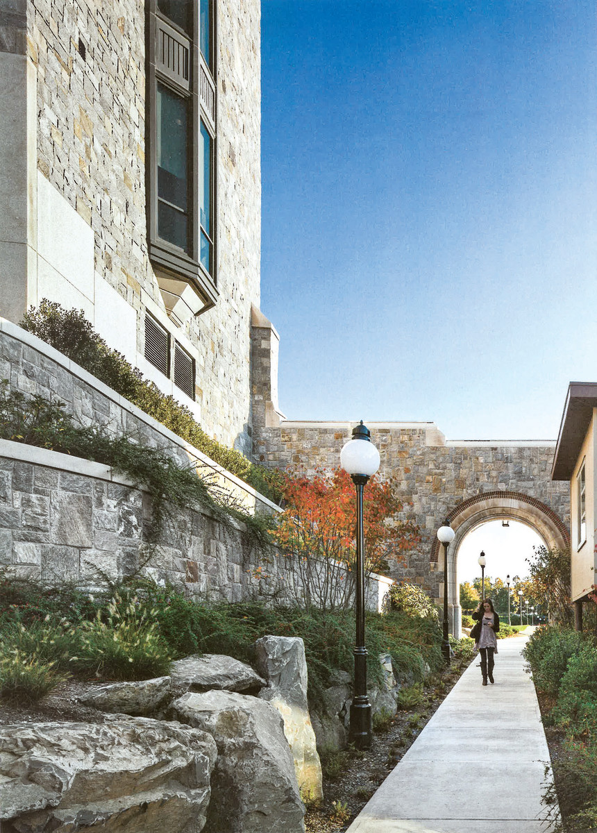 For the Hancock Museum at Marist Center in New York's Hudson River Valley, RAMSA partners Graham Wyatt and Kevin Smith used Hudson Valley rubblestone facades to enhance campus character established by earlier Gothic Revival buildings. Extending a rubble stone wall to form an arched opening over the adjacent walkway heightens sense of place.