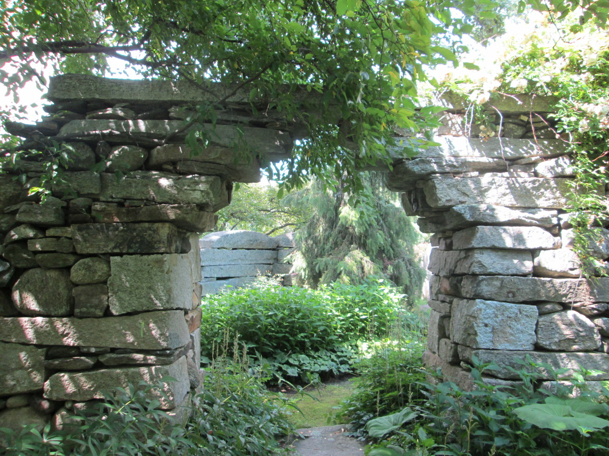 This stone portal beckons us to explore traditional stonework and what lies beyond in this historically inspired garden. Photo: Judy L. Hayward