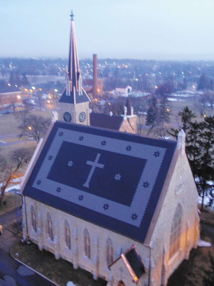 In addition to creating the distinctive cross and stars patterns, the roofers installed synthetic slate tiles and authentic copper flashing on the steeple of the Veterans Administration Medical Center in Dayton, OH, which had formerly been covered with unadorned asphalt shingles. Photo: courtesy of Detroit Cornice and Slate Company