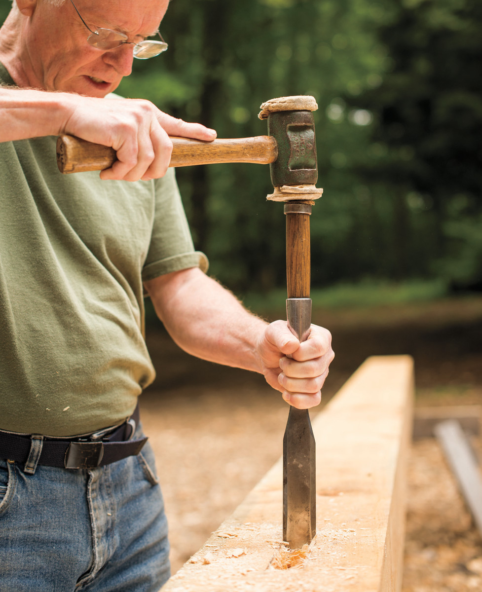 "Author Will Beemer uses a mallet to ""drive the chisel down the ends of the mortise."""