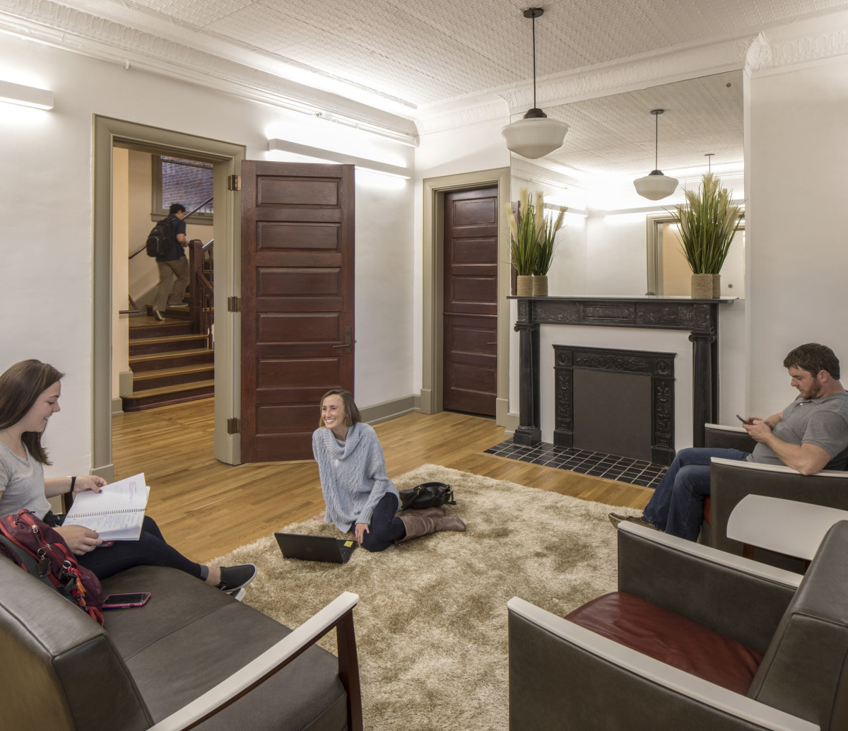 "One of the dorm's former ""living rooms,"" complete with original fireplace, becomes a center for 21st-century study and socialization."