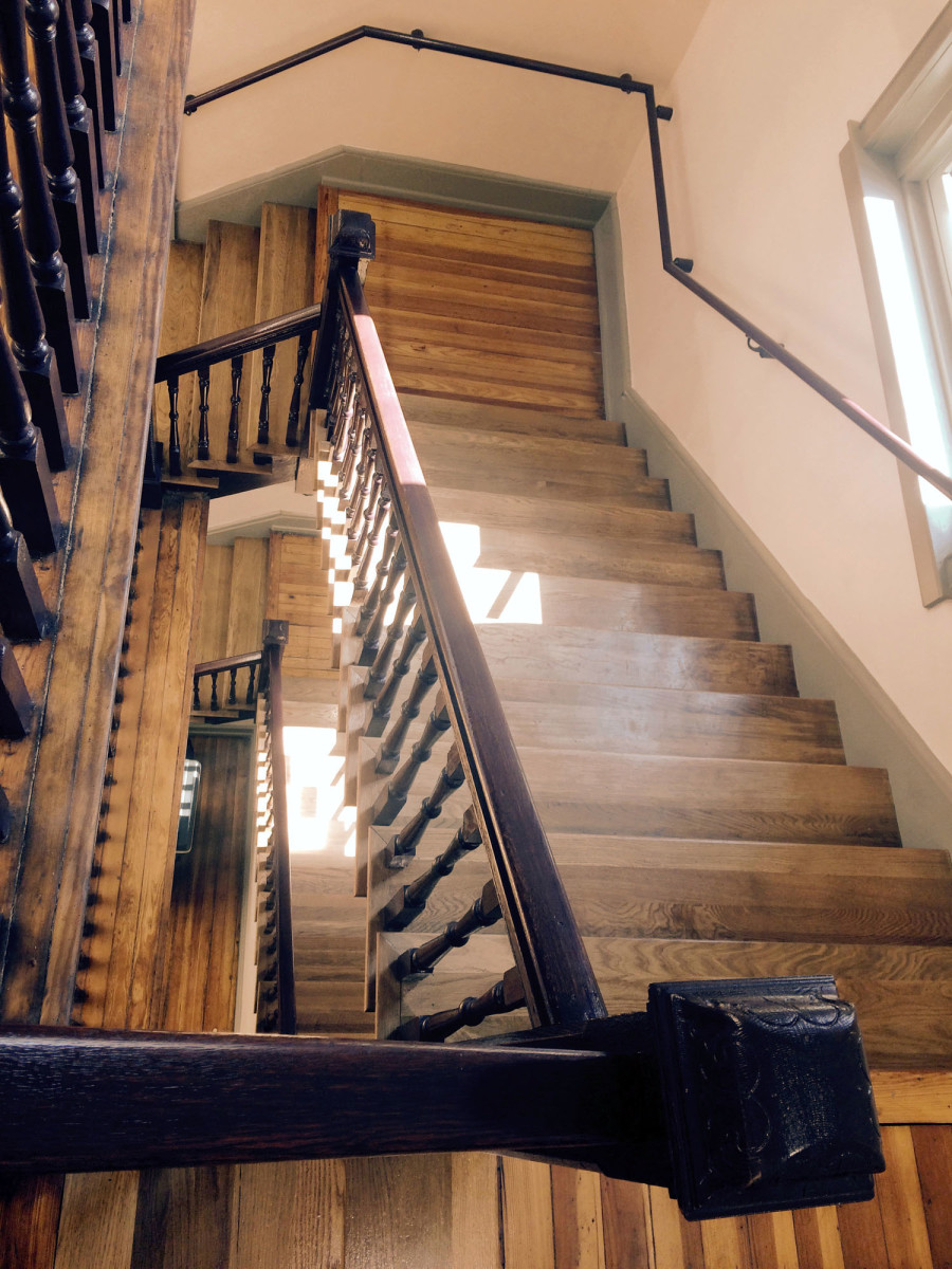 """Lord Aeck Sargent """"unboxed"""" a pair of spiral staircases that mirror each other, preserving the original wooden bannisters."""