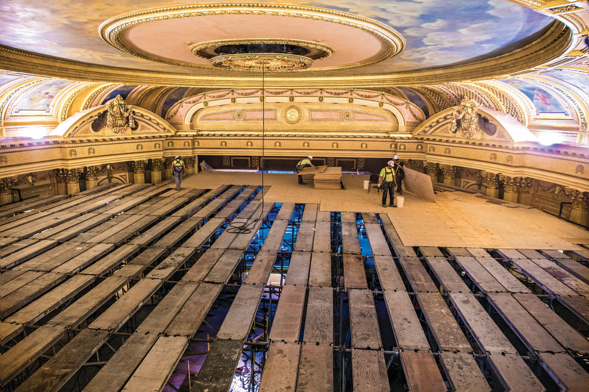 The workers from Badger Ladder and Scaffolding constructed scaffolding in the theater so Evergreene Architectural Arts could work on the murals. This area became known as the dance floor.