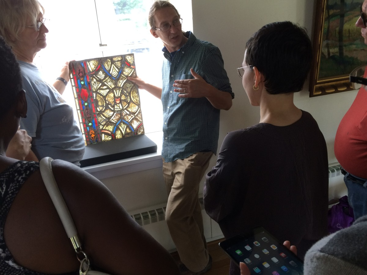 Stephen Hartley discusses leaded glass deterioration using a 15th-century French panel. Photo: J. Kenneth Leap