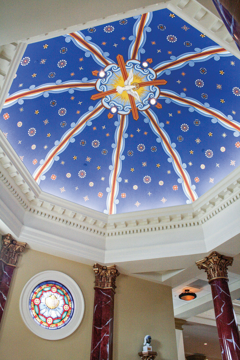 At Saint Michael the Archangel Catholic Church in Leawood, KS, the baptistry mural, by EverGreene Studios, features brightly painted decorative ribbings, heavenly stars and the holy spirit.