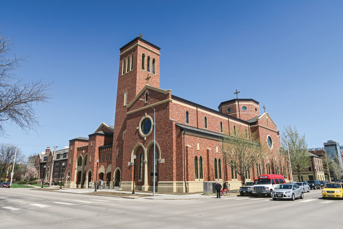 Designed by McCrery Architects, the new Saint Thomas Aquinas Church in Lincoln, NE, is, by necessity, built right to the lot line—in fact, the building corner (right in photo) is directly on the property corner. The Newman Center is in the background. All photos: courtesy of McCrery Architects
