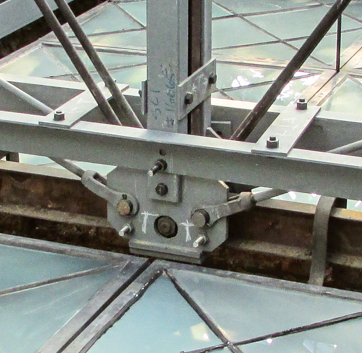 Steel now cradles the historic iron truss providing the capacity to support insulated glass and meet codes for wind, snow, and uneven snow loads.