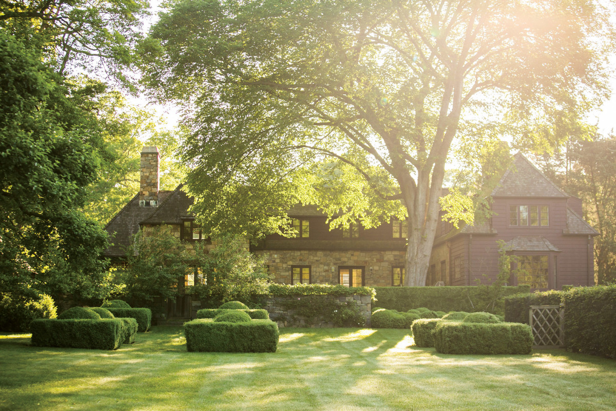 Boxwood topiaries define the back of the house.