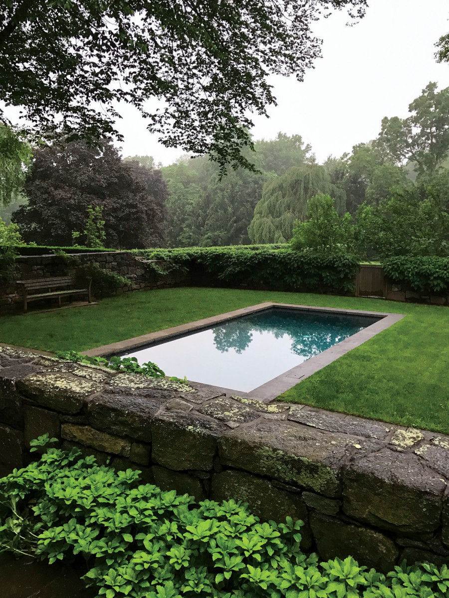 The 12-foot by 24-foot swimming pool is on axis with a new addition to the house and has a direct relationship with the gamecock house that has been repurposed as a pool/dining pavilion.