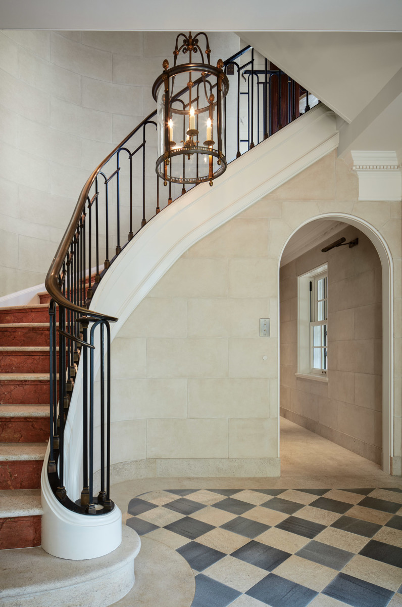 The entry hall's marble stairway, which replaced one made of wood, makes a sweeping entrance.