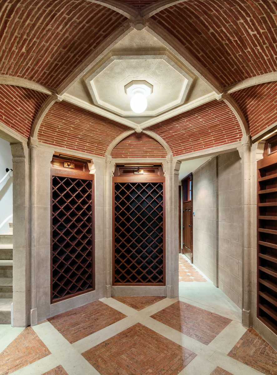 The brick and limestone wine cellar, defined by its vaulted ceiling, is one of the new spaces on the basement floor.