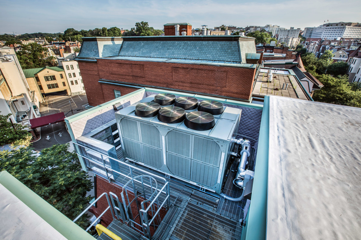 A penthouse and screening conceal the new rooftop mechanical equipment.