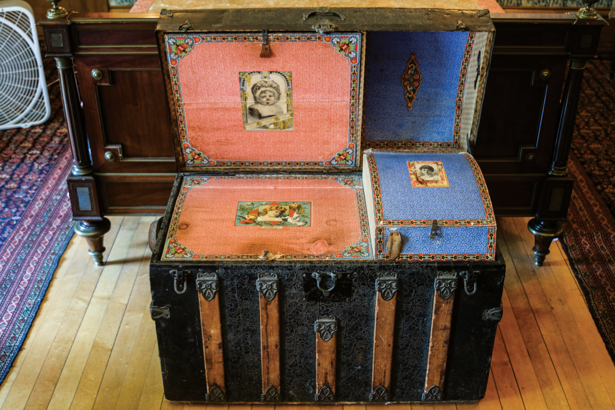 traveling trunk with wallpapered interior