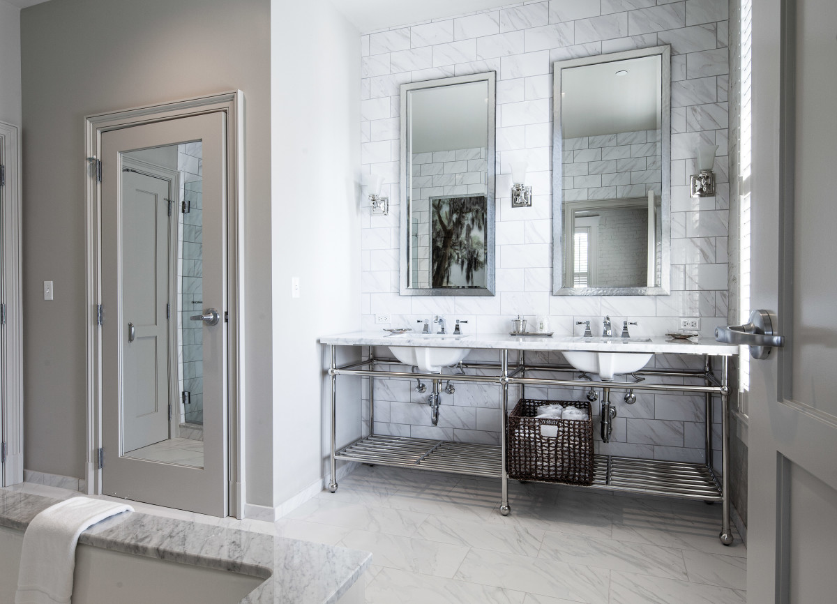The two suites in the hotel feature Carrara marble bathrooms, complete with soaking tub, double vanities, and walk-in glass shower.