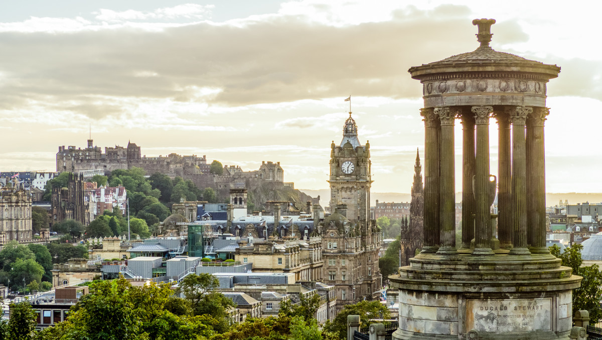 Photograph: View over Edinburgh, with the Dugald Stewart Monument in the foreground. By Ajay Suresh | CC BY 2.0 | recolored from original