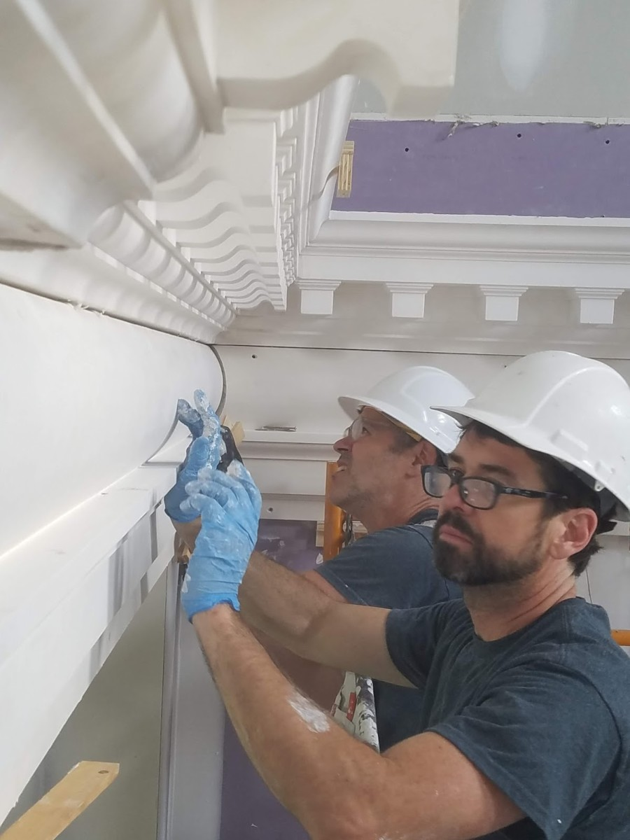 affixing plaster moldings