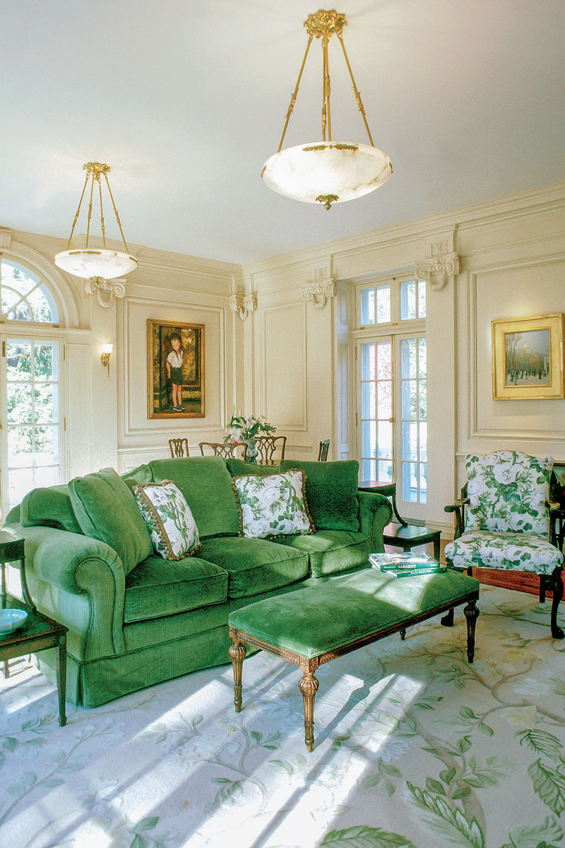 green couch in classical living room