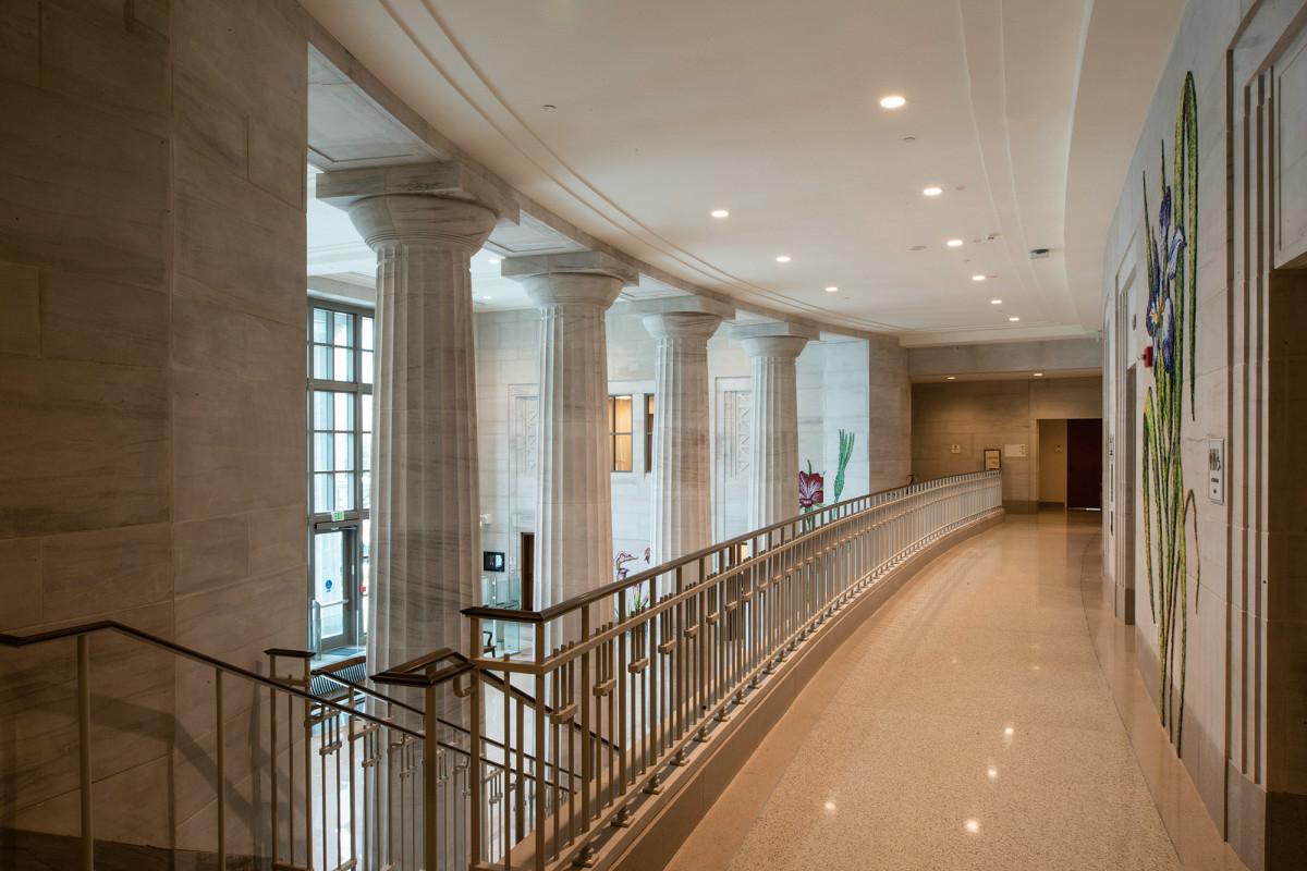 Carved limestone spandrel panels